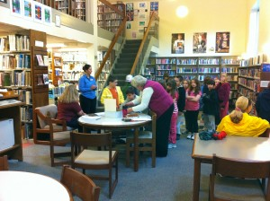 bringing school children into the public library to learn about books.